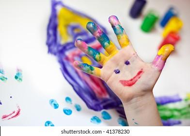 Little Children Hands doing Fingerpainting with various colors