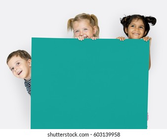 Little Children Holding Empty Paper Smiling