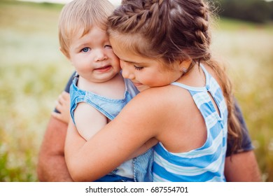Little children hug each other tender