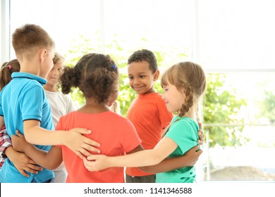 Little children making circle with hands around each other indoors. Unity concept