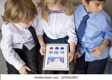 Little children on business meeting working and sharing ideas in office.