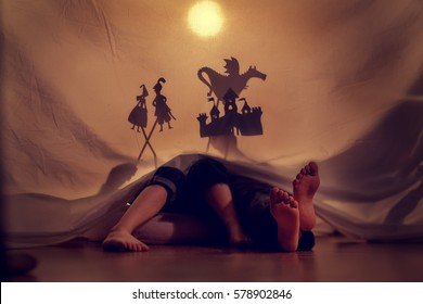 Little children play in the shadow theatre.Theatre. Childhood. Tale.