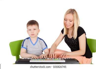 little children playing with the toy composer