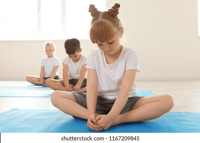 Little children practicing yoga indoors