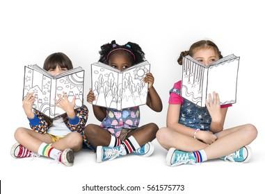 Little Children Reading Sitting Down