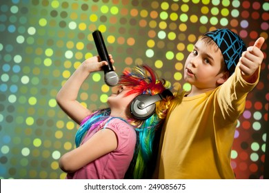 Little children singing, dancing in disco club
