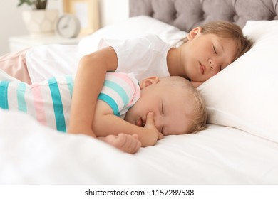 Little children sleeping in bed at home