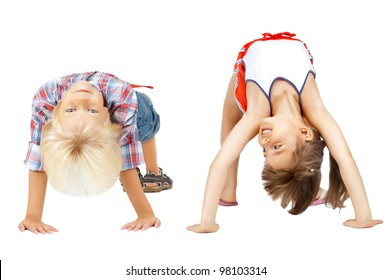little children  stand head over heels and smile, on white background, isolated