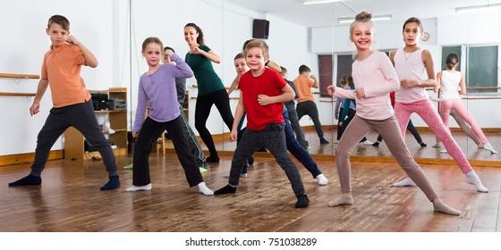 Little children studying contemp dance in studio