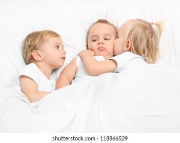 Little children talking before bed in bedroom.