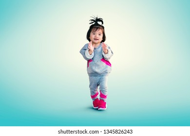 Little Chinese girl portrait with happiness, childhood, freedom, movement. people concept