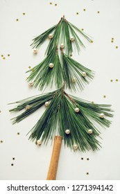 little christmas tree made of pine needles and cinnamon quill