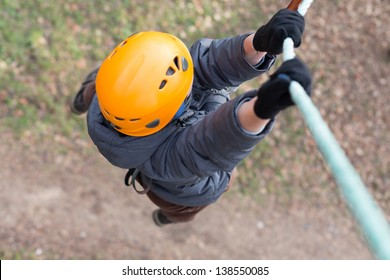 Little climber hanging on a rope