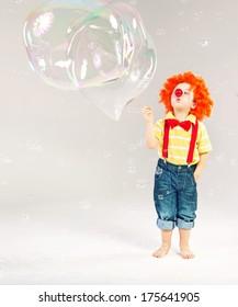 Little clown and bubble soap