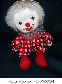 little clown doll wearing polka dot pajamas
