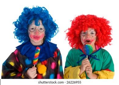 Little clowns with sweet lollipops