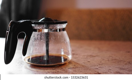 A little coffee at the bottom of the coffee maker. Place for text. The concept of morning, vivacity