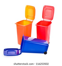little colored containers for disposal. blue, red, orange, isolated on white background