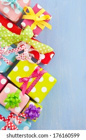 Little colorful gift boxes wrapped in dotted paper