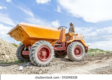 Little construction dumper carrier is at building site.