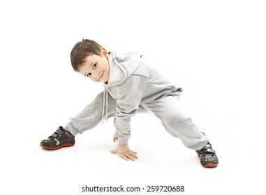 Little cool hip-hop boy in dance. Isolated on white background
