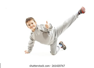 Little cool hip-hop boy in dance showing ok sign. Isolated on white background