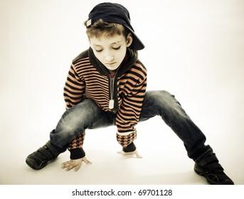 Little cool hip-hop boy in dance. Studio shoot