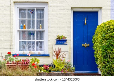 Little cottage with a blue door in Southwold, UK