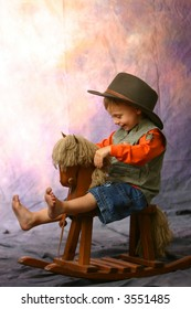Little cowboy with feet up