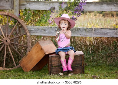Little Cowgirl.  Adorable little girl pretending to be a cowgirl.