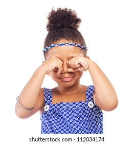 Little crying girl on white background