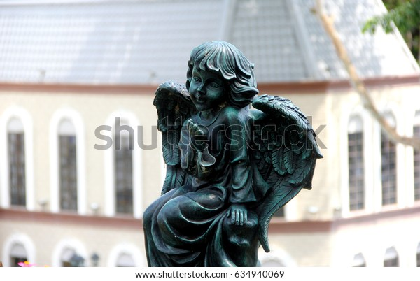 Little cupid statue In strawberry town