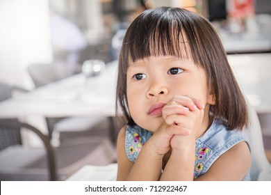 Little cute asian girl praying, close up expression