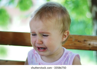 A little cute baby is crying with tears