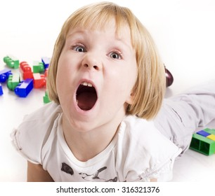 little cute blond girl emotional screaming in camera on white background isolated close up