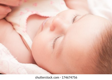Little cute blue-eyed baby