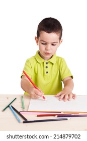 Little cute boy drawing with colorful pencils, isolated on white background
