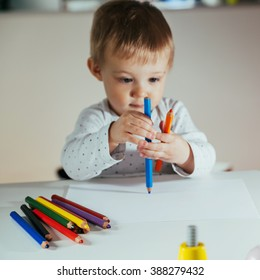 Little Cute Boy Drawing With Colorful Pencils