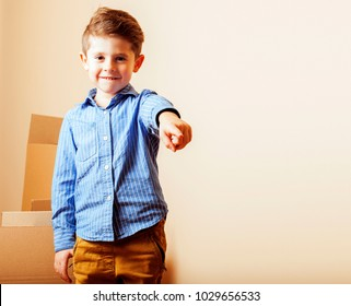 little cute boy in empty room, remoove to new house. home alone,