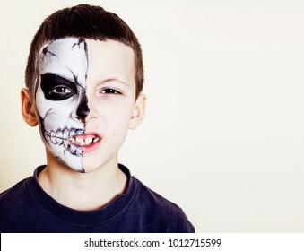 little cute boy with facepaint like skeleton to celebrate hallow