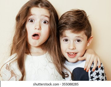 little cute boy and girl hugging playing on white background, happy family smiling brother and sister
