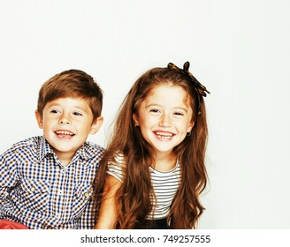 little cute boy and girl hugging playing on white background, ha