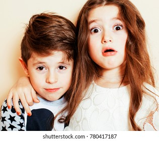 little cute boy and girl hugging playing on white background, happy family smiling brother and sister fooling around, lifestyle people concept