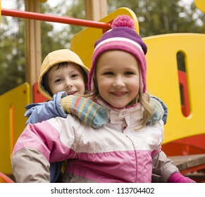 little cute boy and girl playing outside