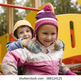little cute boy and girl playing outside, adorable friendship