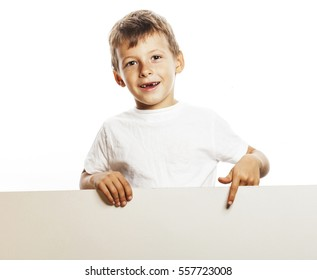 little cute boy holding empty shit to copyspace isolated