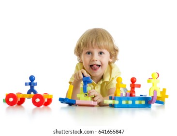Little cute boy playing with building blocks. Isolated on white background.