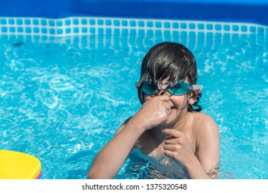 little cute boy playing in the pool