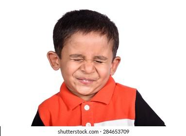 a little, cute boy sour expression