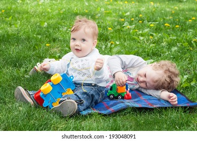Little cute brothers playing on the grass
